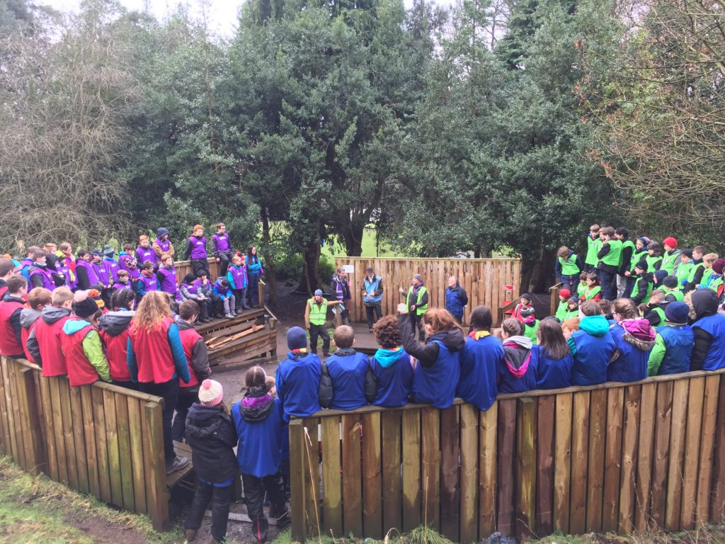 Scouts and leaders at the campfire circle at Bonaly