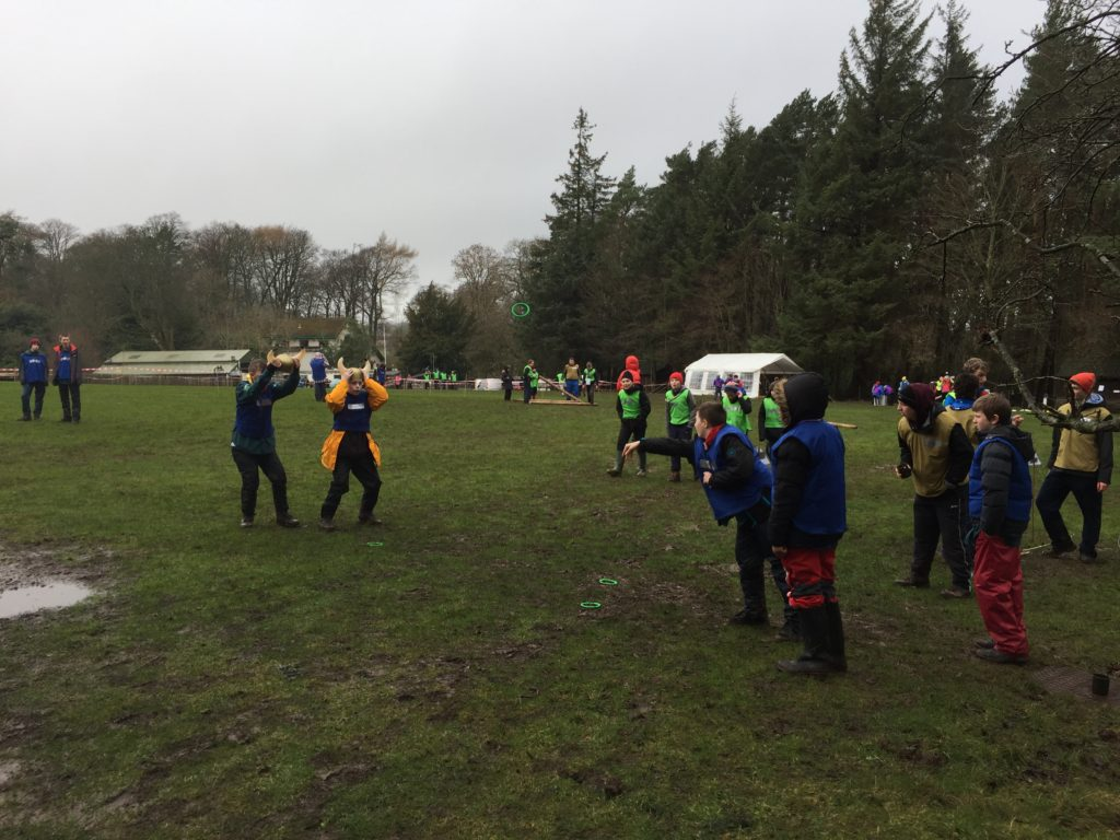 Scouts play hoopla with a viking helmet