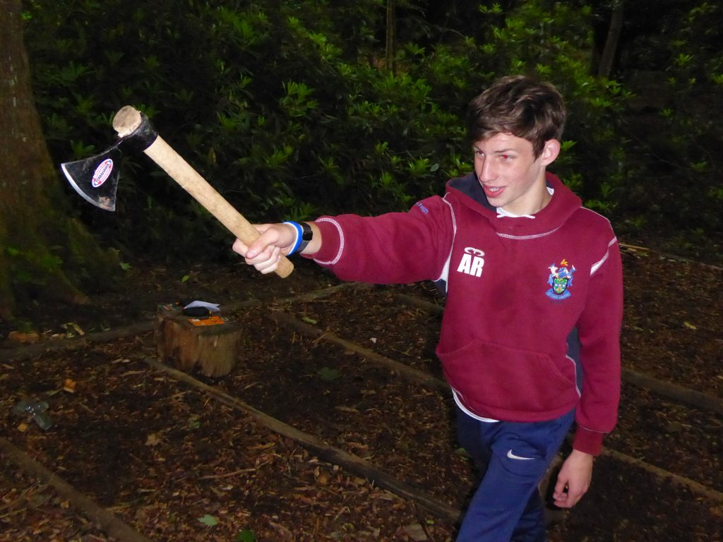 A Scout learns axe throwing