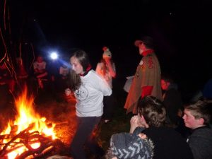 Explorers round a camp fire