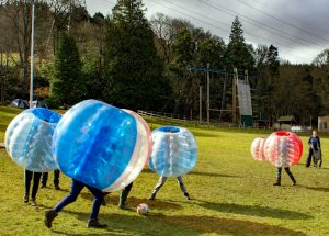 Game with Zorb balls in the field