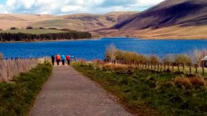 Explorers by reservoir in Pentlands
